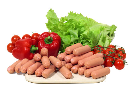 homemakers: mini frankfurters with paprika, tomatos and green salad are waiting for homemakers hand Stock Photo