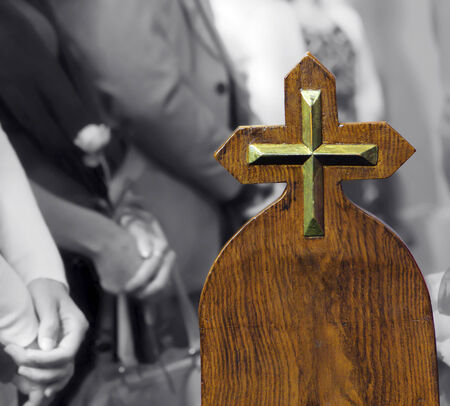 pew: Metallic cross on pew, believers in church
