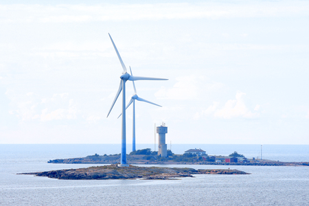 electricity prices: Wind power energy generators at Baltic Sea in Aland region. Stock Photo