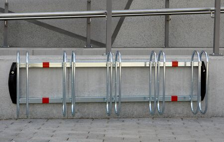 bike parking: Simple bike parking stand,  mounted on wall. Stock Photo