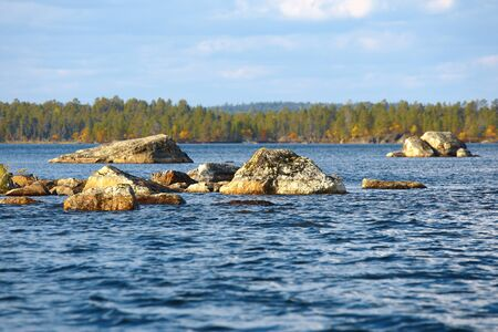 beneath the surface: Sunny day on Lake Inari in early autumn (Lapland, Finland). Navigating on this lake can be dangerous because of rocks right beneath water surface.