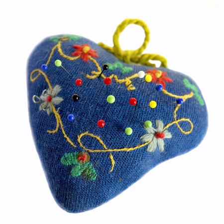 heartshaped: Handmade heart-shaped pin cushion with sewing pins.