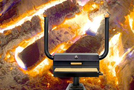 multipurpose: New large multi-purpose cooking oven with bbq and fumigation function (plus cooking plate on lower heating chamber) against glowing billets background.