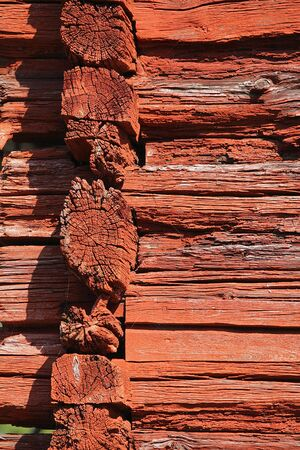 log wall: Ancient log wall corner painted red. Photographed in Aland Islands.