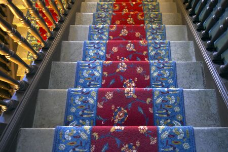 stairs interior: Marble stairs covered with carpet in mansion. Stock Photo