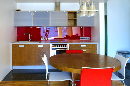 kitchen furniture: Modern kitchen furniture - glass, wood and vivid colors. Stock Photo