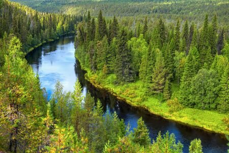 Curving Oulanka river in Oulanka National Park alongside river several hiking routes. Imagens