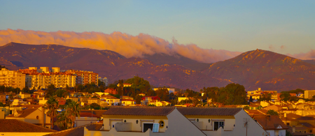 spirited: Panoramic view of Algeciras in sunset with clouds hanging over mountains, Spain.