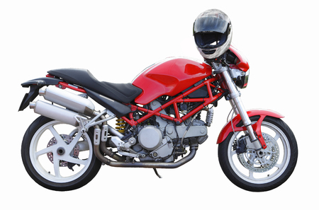 crash helmet: Modern red motorbike with crash helmet, isolated on white.