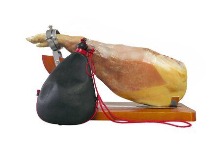 herdsman: Spanish  ham and typical spanish portable wineskin, isolated on white.
