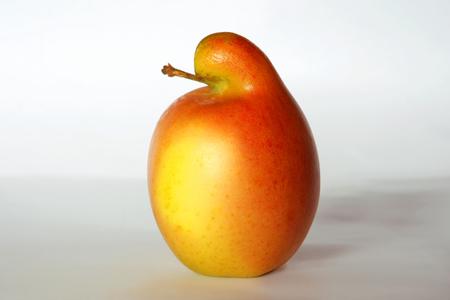 Bird- like red apple, not digitally manipulated. Stock Photo