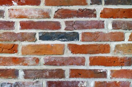 build up: Ancient red bricks used to build up a new wall. Stock Photo