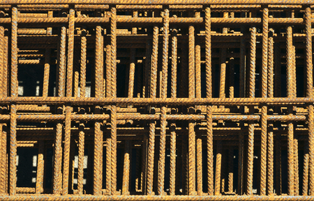 reinforcing: Rusty reinforcing mesh in heap. Stock Photo