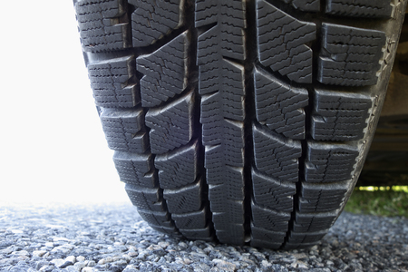 tyre tread: All year round car tire on dry asphalt in summer. Stock Photo