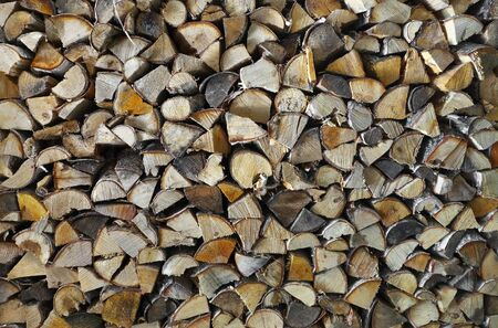calorific: Chopped firewood (birch) in stack, background. Stock Photo