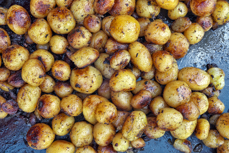 Round uncut spiced French fried potatoes.