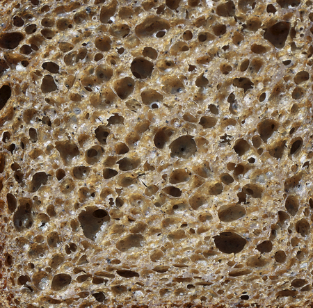 Texture of a brown bread slice. Imagens