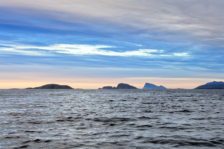 Sunset on the waters of Senja Island in Norway. Archivio Fotografico - 120518997