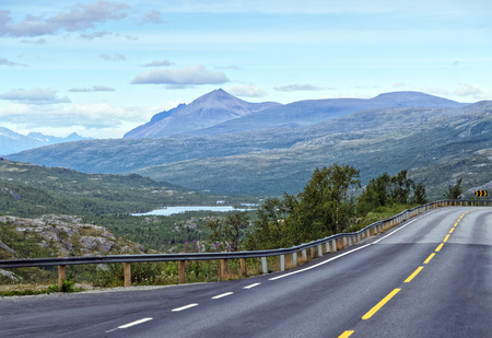 Highway in Northern Norway through the mountains in summer.