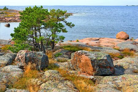 Rocky red granite seashore in Käringsund, Aland Islands (Finland).