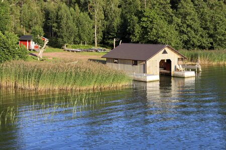Summer evening view with boathouse in Aland Islands, Finland.