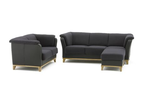 Black modern sofa set with ottoman, isolated on white. Materials used: genuine leather, textile, oakwood. 스톡 콘텐츠