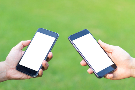 Close-up of two a man hands people  using smartphone. concept of social networking