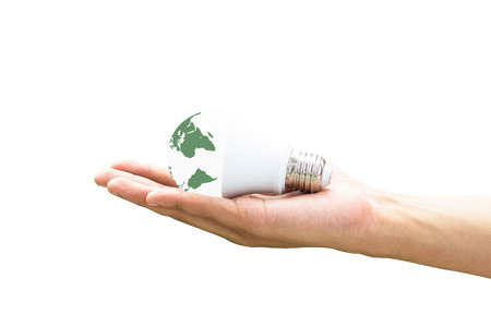 Hand holding LED Bulb with Lighting on green nature background. Eco power saving concept . alternative energy and Eco technology concept.