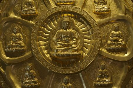 The circle of golden buddha on the wall photo
