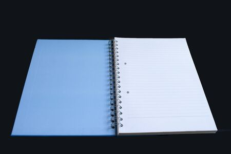 prose: open blue book on a black background  Stock Photo
