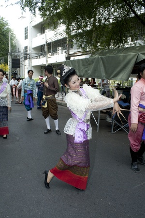 BANGKOK, THAILAND - OCTOBER 2: An unidentified woman performs a Thai traditional dance during a parade of people from the northern territory of Thailand, October 2, 2011 in Bangkok, Thailand.