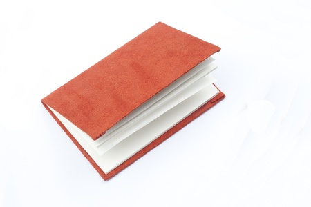 red book isolated on white photo
