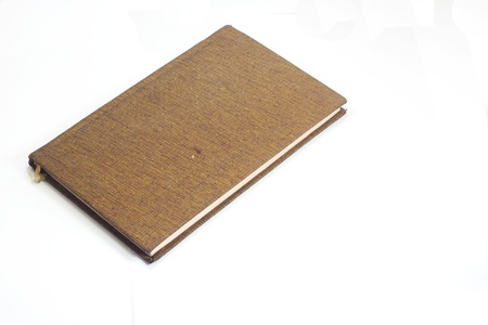 brown book isolated on white photo