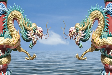 Chinese style dragon statue on sky and sea photo