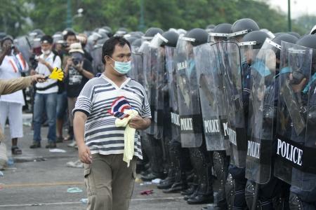 BANGKOK,THAILAND-NOVEMBER,24 Police Commandos guard a barricade on Makkhawan Bridge outside Government HQ on November 24,2012 in Bangkok, Thailand