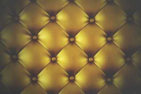 Luxury golden leather close-up background photo