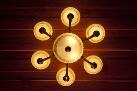 Vintage ceiling lamp fixture in dark hallway photo