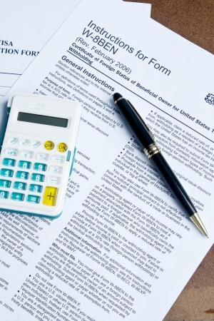 u s: U S  Tax form, pen and calculator Stock Photo