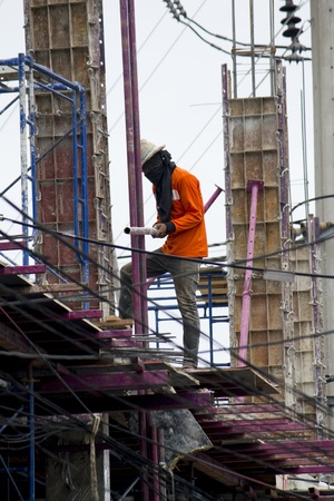 labor working in construction site photo