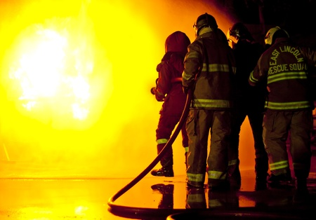 fire team: Firefighters attack a propane fire during a training exercise