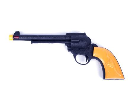 Yellow toy gun isolated on white Stock Photo