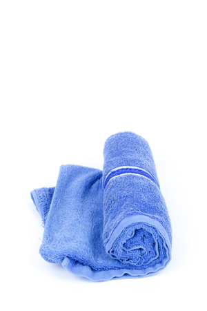 blue towel rolled up on a white background Stock Photo