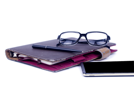 Notebook,pen, smartphone and eye glasses