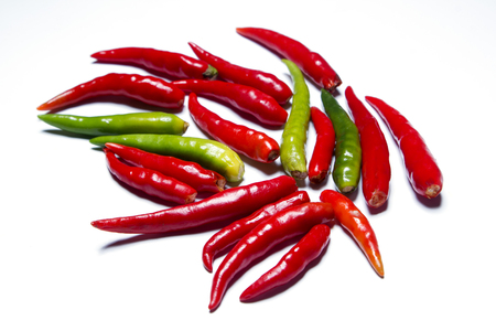chilli peppers on white surface