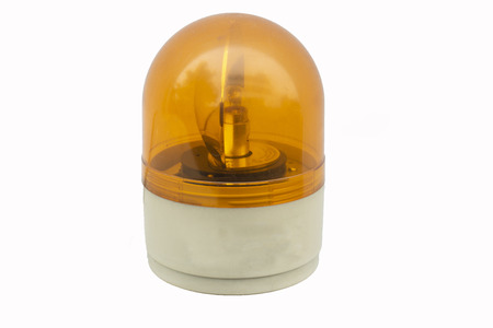 Emergency orange alert light closeup isolated on white background