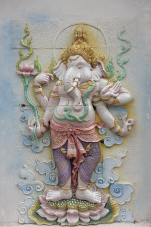 carving decorated ganesha statue on wall