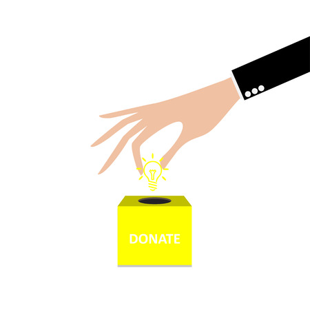 business hand: business hand putting light bulb into the box donation