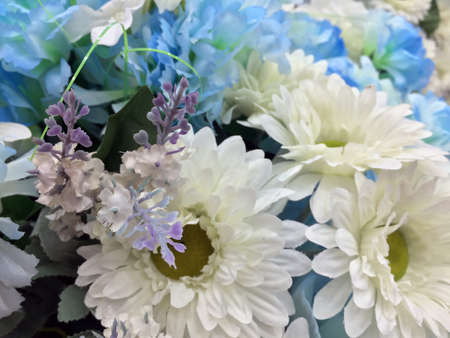 White and light blue color of Flower bouquet, all of it made from fabric. it is an attractively arranged bunch of flowers, especially one presented as a decorate.