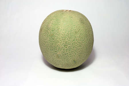 Cantaloupe on white background. It is a small, round melon of a variety with orange flesh and ribbed skin. 스톡 콘텐츠