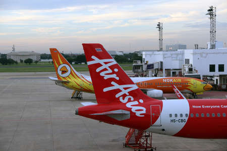 Don muang, Bangkok, Thailand, June 6, 2018 : Boeing 737-800 of Nokair and the tail of the plane of Thai Airasia, Airbus A320  is parked on the parking lot.